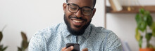 Smiling African Businessman Si...
