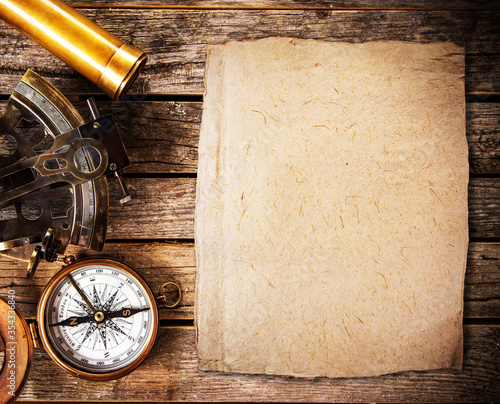 Obraz Top view of accessories for travel on vintage wooden background with lots of copy space. Preparing for an adventure trip or sightseeing. - fototapety do salonu