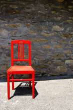 Wooden Red Chair In The Sun