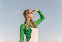 Young Woman Shielding Eyes Aga...