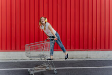 Girl With A Shopping Cart And ...