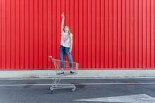 Girl In A Shopping Cart Pointi...