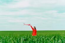 Woman Wearing Red Dress Standi...