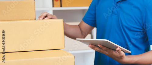 Fotografie, Obraz The shipping company checking parcels list before delivering to customers