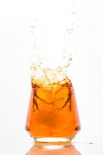 Whiskey Glass Ice Ball Falling Splash