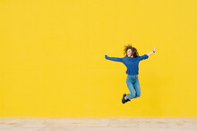 Young Woman Jumping In The Air...