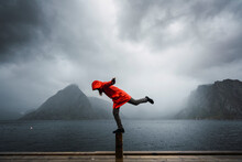 Norway, Lofoten, Man Balancing...
