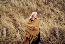 Fashionable Young Woman Wearing Light Brown Cape