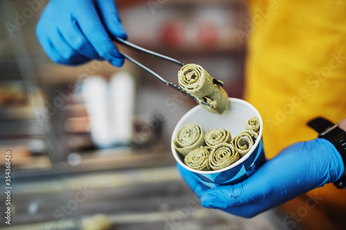 Stir-fried ice cream rolls at freeze pan Canvas Print