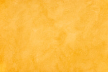 Ocher Yellow Painted Background With Brush Stroke Pattern And Wall Texture.