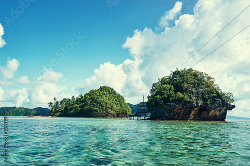 Fényképezés Beautiful landscape with blue sea, tropical islands and fishing houses on stilts in mangrove lagoon, Siargao Island, Philippines