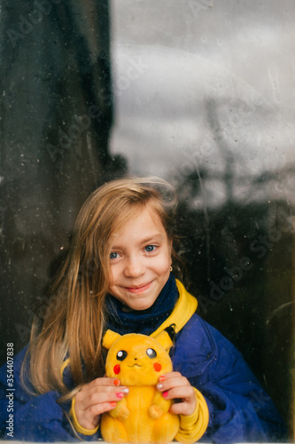 MInsk, Belarus - December 8, 2019: Lovely girl in jacket and hoody holds pikachu фототапет