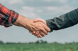 Leinwandbild Motiv Mortgage loan officer and farmer shaking hands upon reaching an agreement