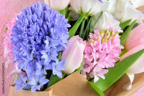 Fototapeta Spring flowers background, selective focus. Tulips, eustoma and hyacinthus flowers, close up.  obraz na płótnie