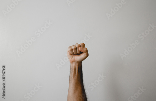 Fotografiet Fist raised with white background