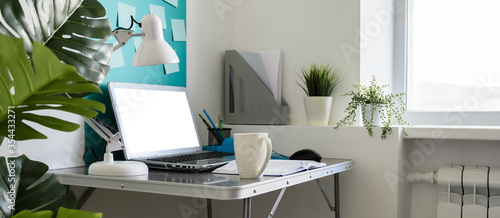 Obraz Home office workplace with laptop. Modern creative workspace at home. Banner - fototapety do salonu