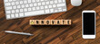 Leinwandbild Motiv cubes with message INNOVATE and office equipment on wooden background