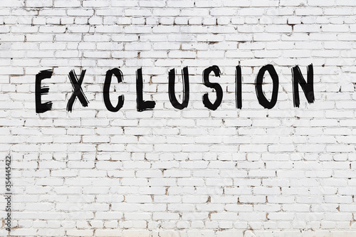 Word exclusion painted on white brick wall Canvas-taulu