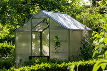 Idyllic Garden With Greenhouse In Early Summer Late Spring