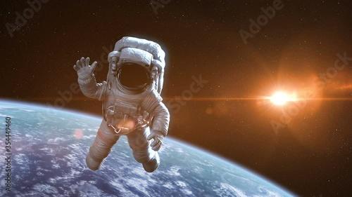 Cuadros en Lienzo Astronaut in Outer Space against Earth Backgound