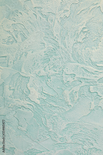 Fototapeta Wall with decorative venetian stucco of light green color. Luxury background. Vertical fragment. obraz