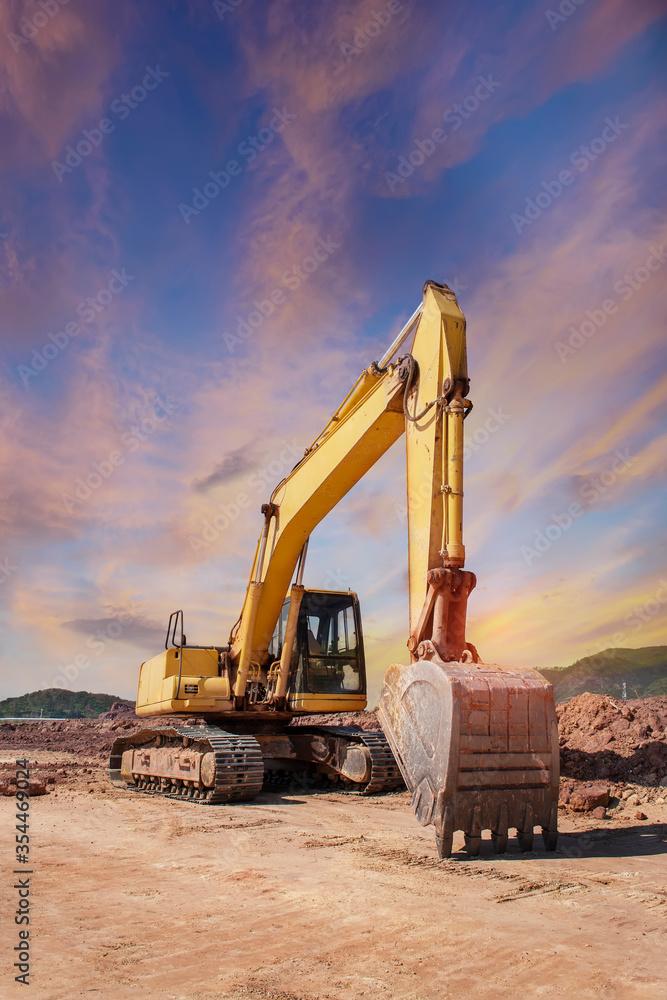 Fototapeta huge heavy shovel excavator digger on gravel construction site