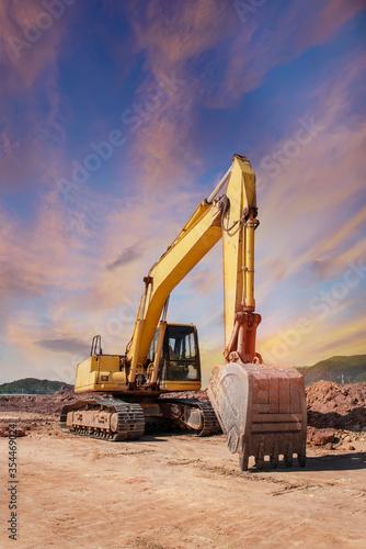 Fototapeta huge heavy shovel excavator digger on gravel construction site obraz