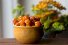 Cloudberry Rubus Chamaemorus Close Up In Orange Bowl On Wooden Table,autumn Harvest In Norwegian Mountains Near Hemsedal Ski Resort,Buskerud,Norway,photo For Printing On Calendar,poster,wallpaper