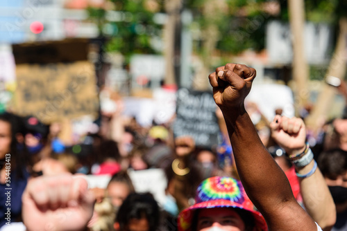 Miami Downtown, FL, USA - MAY 31, 2020: Black hand at a peaceful protest. Human rights. The situation in the USA with demonstrations after Minneapolis killing. George Floyd death.