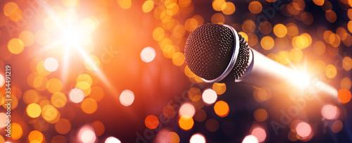 Fényképezés Microphone against dark background with defocused lights