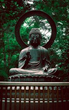 Vertical Shot Of The Statue Of Buddha In The Japanese Tea Garden In The USA