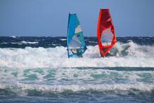 Two Windsurfers In The Breakin...