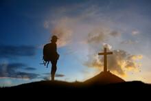 Man Standing Holding Christian...