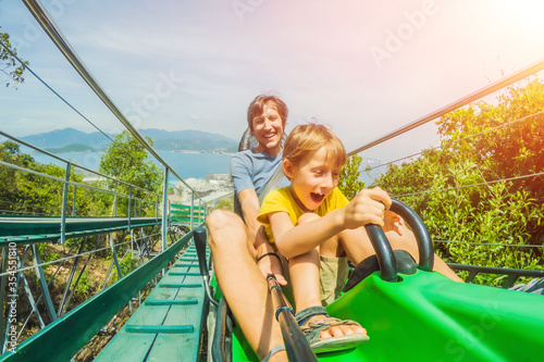 Photo Father and son on the alpine coaster