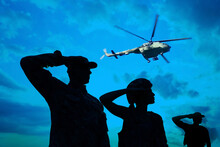 Silhouettes Of Soldiers In Uniform Saluting And Military Helicopter Outdoors