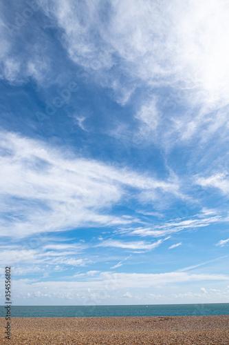 Fotografija Empty beach with wispy cloudscape