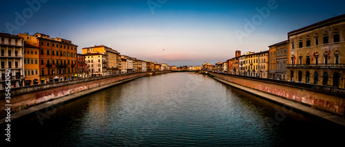 Fotografering Pisa, Tuscany, Italy Arno riverscape view from bridge at sunset