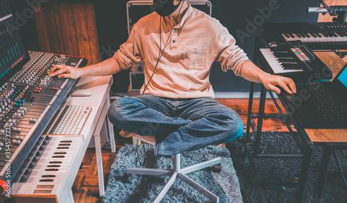 retro portrait of male music producer working in home recording studio Canvas Print