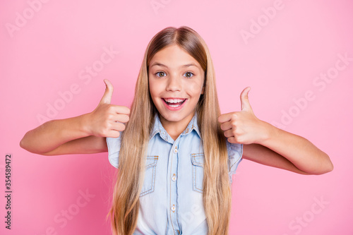 Fototapeta Portrait of energetic crazy kid girl show thumb up sign recommend advise choose