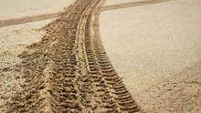 Tire Prints On Beach Sand Left...