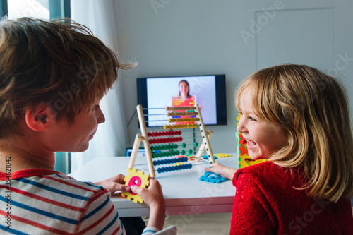 Obraz kids having online math lesson at home, distant learning - fototapety do salonu