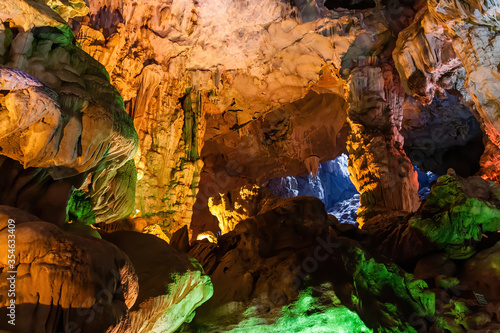 Stalactite and stalagmite formations in a limestone cave of Halong Bay, Vietnam