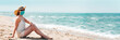 canvas print picture - Woman in sunglasses and straw hat wearing medical mask at beach, new normal rules, web banner. Life after pandemic, obligatory use of face mask in public spaces, copy space