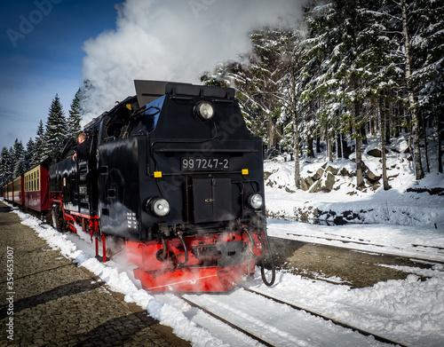 Fototapeta Steam train on the Brocken mountain with snow obraz na płótnie