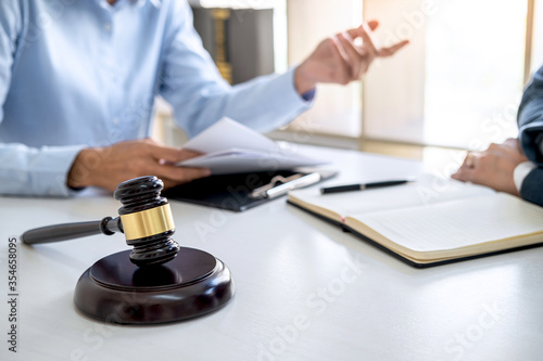 Stampa su Tela Consultation and conference of professional businesswoman and Male lawyers working and discussion having at law firm in office