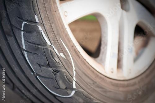 Fototapeta Tear marks on bald tires, car use unsafe tyre dangerous for vehicle. obraz