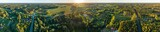 Fototapeta Fototapety na ścianę - Aerial view of amazing sunset at summer season. Nature landscape. Fields, rivers and trees.