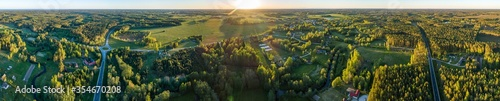 Fototapeta Aerial view of amazing sunset at summer season. Nature landscape. Fields, rivers and trees. obraz
