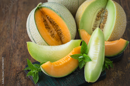 Fotografie, Obraz Juicy ripe melons on the wooden table