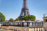 Fototapeta Wieża Eiffla - Eiffel Tower with a residential building in forefront